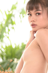 Sowan With Her Slender Thighs Parted To Expose Her Shaved Pussy