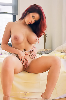 Bianca Beauchamp posing naked on bed for Playboy