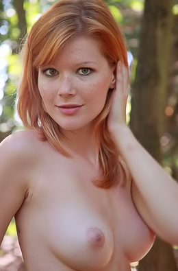 Mia Sollis Redhead slut with tight body poses naked in the forest