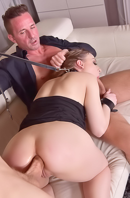 Slave girl Lilit Sweet submits to two masters to fill her up