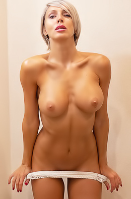 Tanita poses nude sensually in front of a big mirror